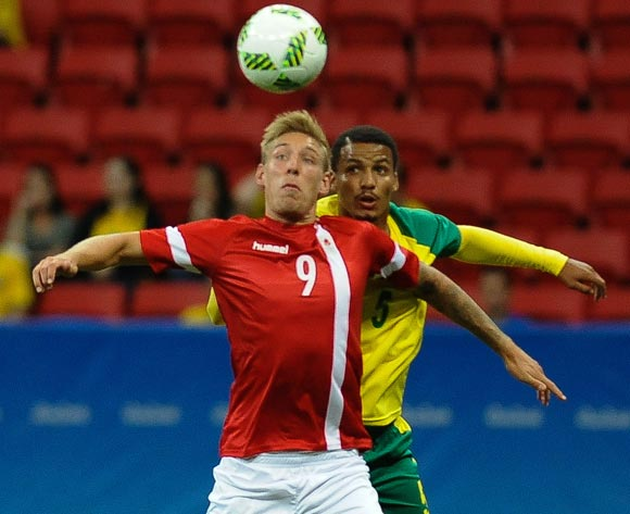 epa05463513 Brock Madsen of Denmark (L) and Rivaldo Coetzee of South Africa vie for the ball during the men's preliminary round group A match between Denmark and South Africa of the Rio 2016 Olympic Games Soccer tournament at the Mane Garrincha Stadium in Brasilia, Brazil, 07 August 2016.  EPA/ANDRESSA ANHOLETE BRAZIL OUT