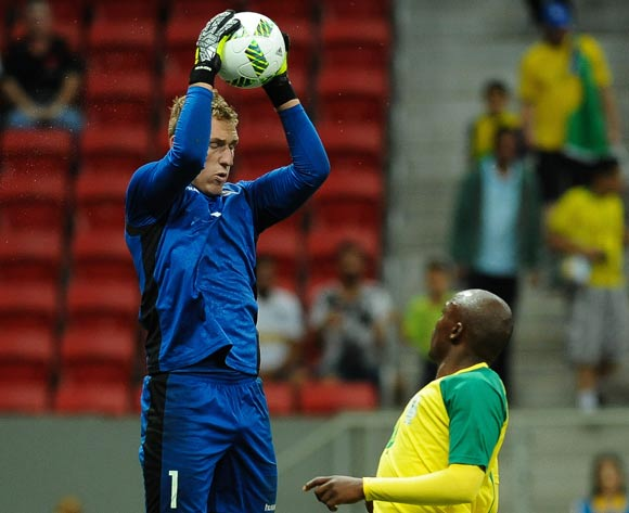 epa05463516 Denmark goalkeeper Jeppe Hojbjerg (L) saves the ball before Gift Motuba of South Africa (R) during the men's preliminary round group A match between Denmark and South Africa of the Rio 2016 Olympic Games Soccer tournament at the Mane Garrincha Stadium in Brasilia, Brazil, 07 August 2016.  EPA/ANDRESSA ANHOLETE BRAZIL OUT