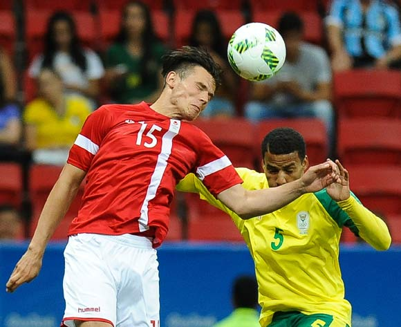 epa05463515 Pascal Gregor of Denmark (L) and Rivaldo Coetzee of South Africa (R) vie for the ball during the men's preliminary round group A match between Denmark and South Africa of the Rio 2016 Olympic Games Soccer tournament at the Mane Garrincha Stadium in Brasilia, Brazil, 07 August 2016.  EPA/ANDRESSA ANHOLETE BRAZIL OUT