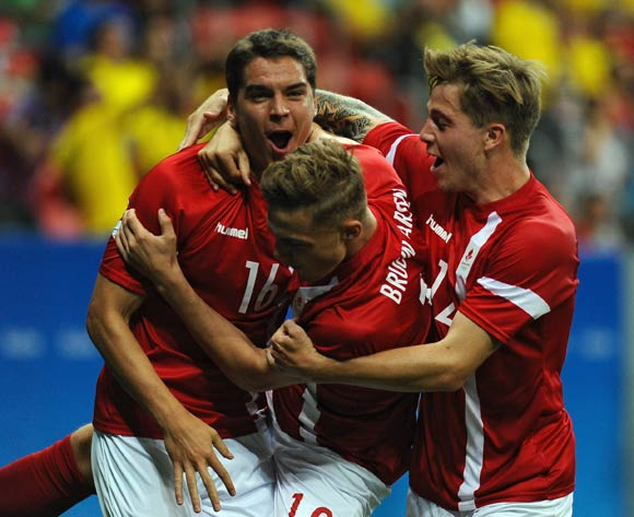 epa05463596 Robert Skov of Denmark (L) celebrates his goal during the men's preliminary round group A match between Denmark and South Africa of the Rio 2016 Olympic Games Soccer tournament at the Mane Garrincha Stadium in Brasilia, Brazil, 07 August 2016.  EPA/ANDRESSA ANHOLETE BRAZIL OUT