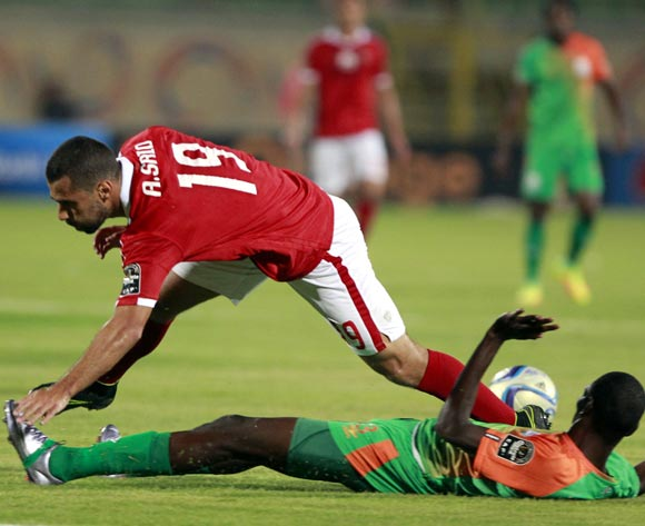 epa05478115 Al-Ahly's Abdallah Said (L) in action  against Zesco United's Misheck Chaila (R) during the African Champions League (CAF) group stage match between Al-Ahly and Zesco United in Suez, Egypt, 12 August 2016.  EPA/KHALED ELFIQI