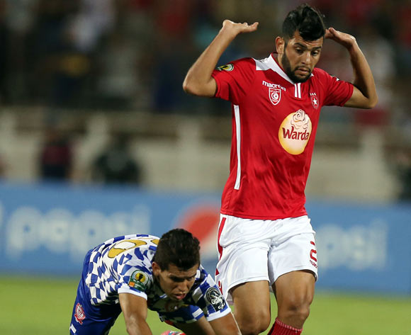 Etoile Sportive du Sahel player  Mohamed Amine Ben Amor (R) and Kawkab Marrakech player Youssef Ikram (L) fight for the ball during the CAF Confederation Cup soccer match between Etoile Sportive du Sahel of Tunisia and Kawkab Marrakech of Morocco at the Olympique Stadium in Sousse, Tunisia, 12 August 2016.  EPA/MOHAMED MESSARA