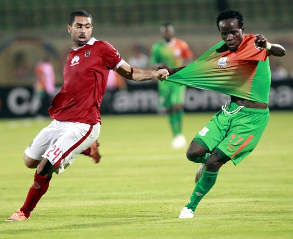 Al Ahly's player Ahmed Fathiy L)  in action against Zesco United  player  Clatous Chama (R) during the African Champions League (CAF) grou stage match between Al Ahly and  Zesco United  at military Stadium in Suez, Egypt, 12 August 2016.  EPA/KHALED ELFIQI