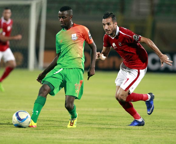 Al Ahly's Ali Maaloul (R) in action against Zesco United's John Ching'andu (L) during the African Champions League (CAF) group stage match between Al Ahly and Zesco United at the military Stadium in Suez, Egypt, 12 August 2016.  EPA/KHALED ELFIQI