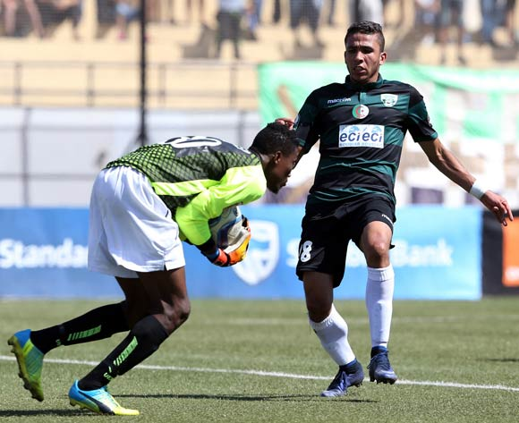 epa05507657 Mouloudia olympique Bejaia player Athmani Mohamed (R) and Medeama Sc goalkeeper Daniel Agyei  (L) fight for the ball during the CAF Confederation Cup soccer match between Mouloudia olympique Bejaia of Algeria and Medeama SC of Ghana at the Maghreb unity stadium in Bejaia 250km east of Algiers, Algeria, 23 August 2016.  EPA/STR