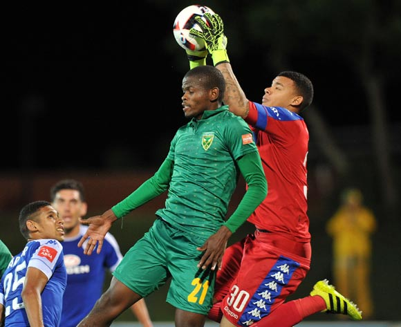 Nkanyiso Mngwengwe of Golden Arrows challenged by Ronwen Williams of Supersport United during the Absa Premiership 2016/17 match between Golden Arrows and Supersport United at Princess Magogo Stadium, KwaMashu South Africa on 28 September 2016 ©Muzi Ntombela/BackpagePix