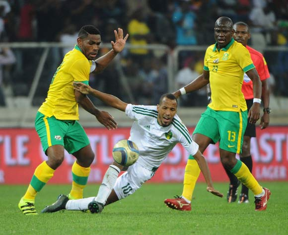 Thulani Hlatshwayo of South Africa is challenged by Boubacar Bagili of Mauritania during the AFCON Qualifier match between South Africa and Mauritania 02 September 2016 at Mbombela Stadium Pic Sydney Mahlangu/ BackpagePix
