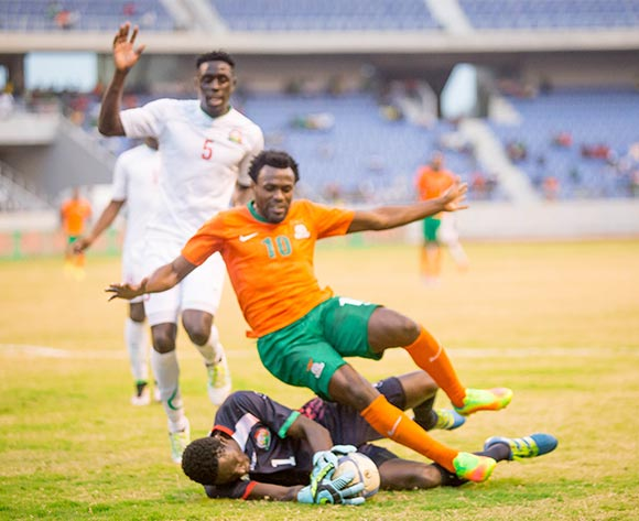 Zambian striker Winstone Kalengo is beaten to ball by Kenyan goalkeeper Bonface Oluach during the AFCON Qualifier match between Zambia and Kenya 04 September 2016 at Levy Mwanawasa Stadium Pic/ BackpagePix