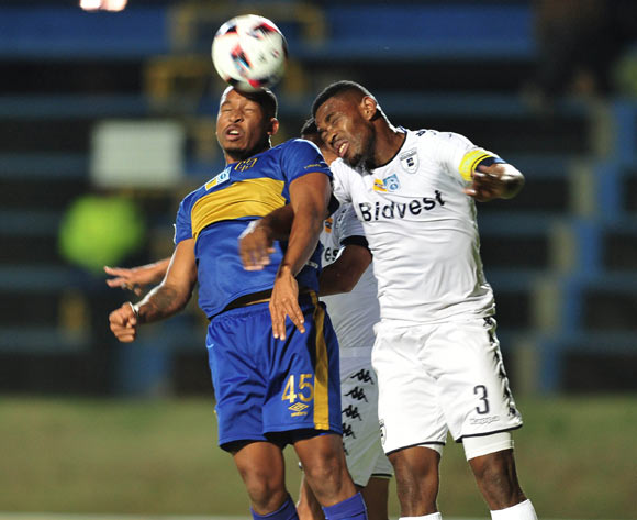 Lehlohonolo Majoro of Cape Town City challenged by Thulani Hlatshwayo of Bidvest Wits during the 2016 MTN 8 Semi Final match between Bidvest Wits and Cape Town City at the Bidvest Stadium in Johannesburg, South Africa on September 10, 2016 ©Samuel Shivambu/BackpagePix