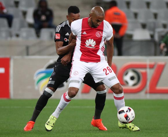 Nathan Paulse of Ajax Cape Town evades challenge from Happy Jele of Orlando Pirates during the Absa Premiership 2016/17 football match between Ajax Cape Town and Orlando Pirates at Cape Town Stadium, Cape Town on 13 September 2016 ©Chris Ricco/BackpagePix