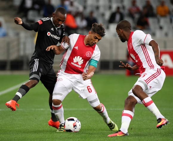 Thabo Rakhale of Orlando Pirates tackled by Travis Graham of Ajax Cape Town and Mosa Lebusa of Ajax Cape Town during the Absa Premiership 2016/17 football match between Ajax Cape Town and Orlando Pirates at Cape Town Stadium, Cape Town on 13 September 2016 ©Chris Ricco/BackpagePix