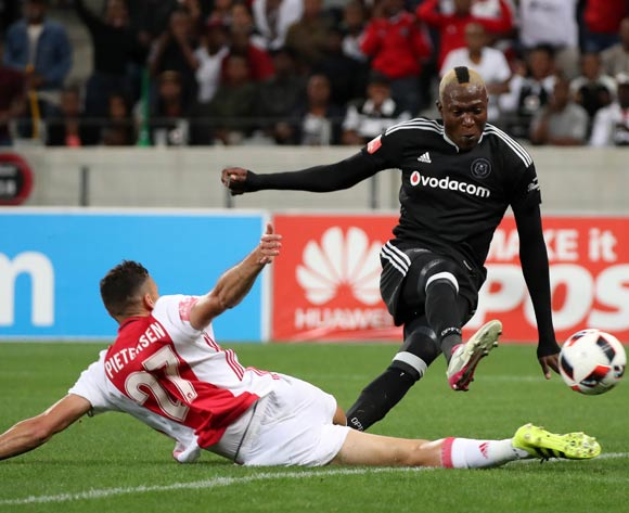 Tendai Ndoro of Orlando Pirates rounds Roscoe Pietersen of Ajax Cape Town to score a goal during the Absa Premiership 2016/17 football match between Ajax Cape Town and Orlando Pirates at Cape Town Stadium, Cape Town on 13 September 2016 ©Chris Ricco/BackpagePix