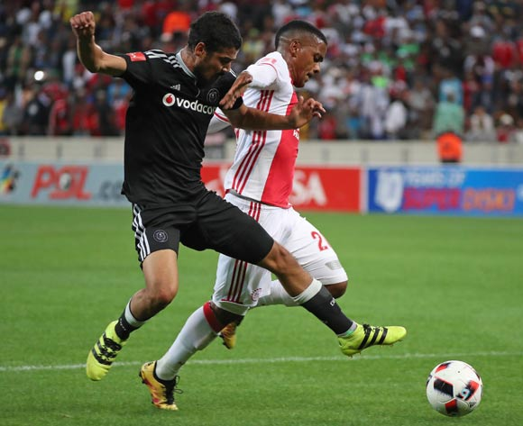 Erwin Isaacs of Ajax Cape Town tackled by Abbubaker Mobara of Orlando Pirates during the Absa Premiership 2016/17 football match between Ajax Cape Town and Orlando Pirates at Cape Town Stadium, Cape Town on 13 September 2016 ©Chris Ricco/BackpagePix