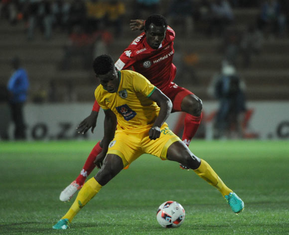 Nyasia Munetsi of Baroka FC challenges Charlton Mashumba of Highlands Park during the Absa Premiership match between Highlands Park and Baroka FC 13 September 2016 at Makhulong Stadium  Pic Sydney Mahlangu/ BackpagePix
