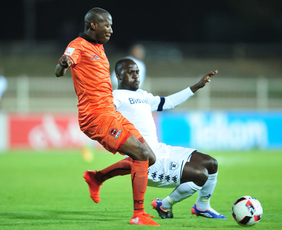 Jabulani Maluleke of Polokwane City tackled by Cuthbert Malajila of Bidvest Wits during the Absa Premiership match between Polokwane City and Bidvest Wits at the Old Peter Mokaba Stadium in Polokwane, South Africa on September 13, 2016 ©Samuel Shivambu/BackpagePix