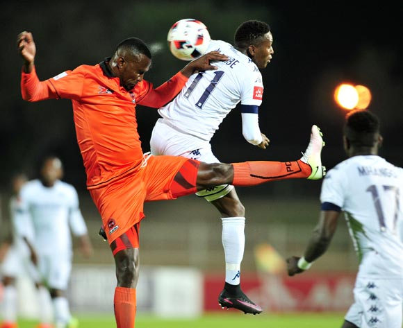 Thapelo Tshilo (r) of Polokwane City challenged by Elias Pelembe (c) of Bidvest Wits during the Absa Premiership match between Polokwane City and Bidvest Wits at the Old Peter Mokaba Stadium in Polokwane, South Africa on September 13, 2016 ©Samuel Shivambu/BackpagePix