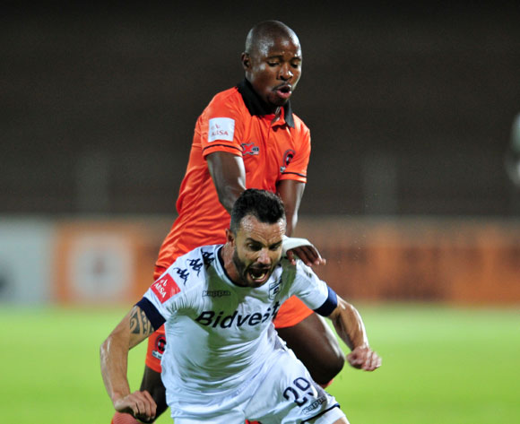 Dillon Sheppard of Bidvest Wits challenged by Puleng Tlolane of Polokwane City during the Absa Premiership match between Polokwane City and Bidvest Wits at the Old Peter Mokaba Stadium in Polokwane, South Africa on September 13, 2016 ©Samuel Shivambu/BackpagePix