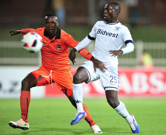 Cuthbert Malajila of Bidvest Wits challenged by Thapelo Tshilo of Polokwane City during the Absa Premiership match between Polokwane City and Bidvest Wits at the Old Peter Mokaba Stadium in Polokwane, South Africa on September 13, 2016 ©Samuel Shivambu/BackpagePix