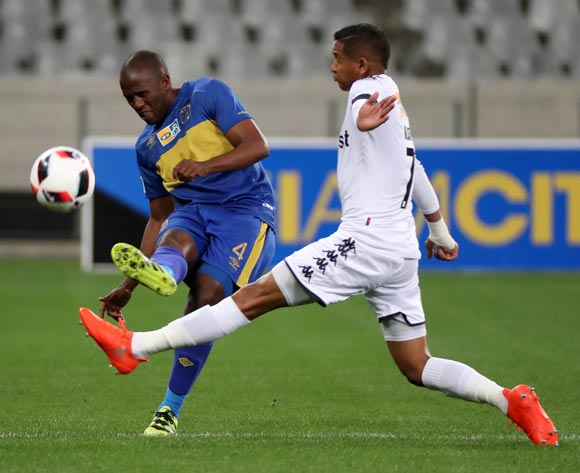 Vincent Kobola of Cape Town City FC evades challenge from Daine Klate of Bidvest Wits during the 2016 MTN 8 Semifinal second leg football match between Cape Town City FC and Bidvest Wits at Cape Town Stadium, Cape Town on 17 September 2016  ©Chris Ricco/BackpagePix