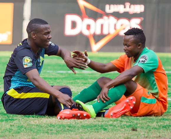 Siyanda Zwane of Mamelodi Sundowns shakes hands with Mwape Mwelwa of Zesco United