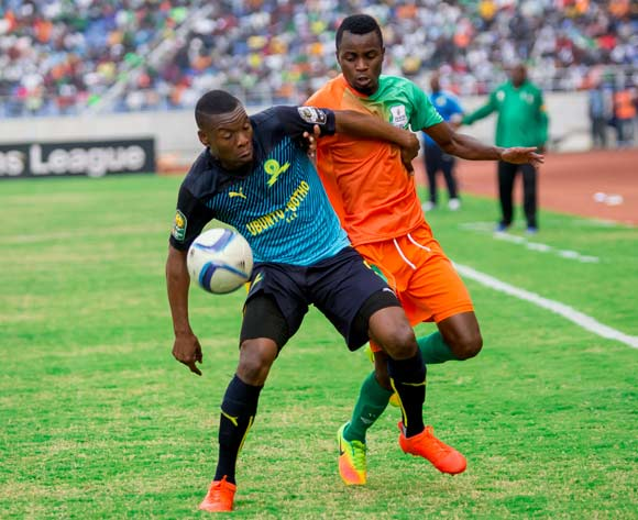 Siyanda Zwane of Mamelodi Sundowns shields the ball from Zesco United midfielder John Chin'gandu