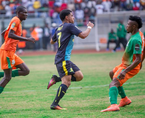 Zesco United's Misheck Chaila and Adama Ben Bahn beaten to the ball by Keagan Dolly of Mamelodi Sundowns