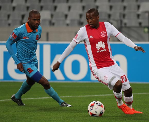 Thabo Mosadi of Ajax Cape Town evades challenge from Sibusiso Mbonani of Polokwane City during the Absa Premiership 2016/17 football match between Ajax Cape Town and Polokwane City at Cape Town Stadium, Cape Town on 20 September 2016 ©Chris Ricco/BackpagePix