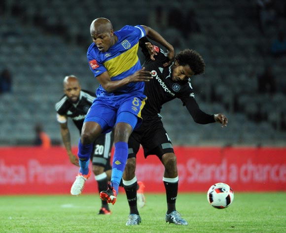 Issa Sarr of Orlando Pirates challenges Lebogang Manyama of Cape Town City during the Absa Premiership match between Orlando Pirates and Cape Town City on the  20 September 2016 at Orlando Stadium  Pic Sydney Mahlangu/ BackpagePix