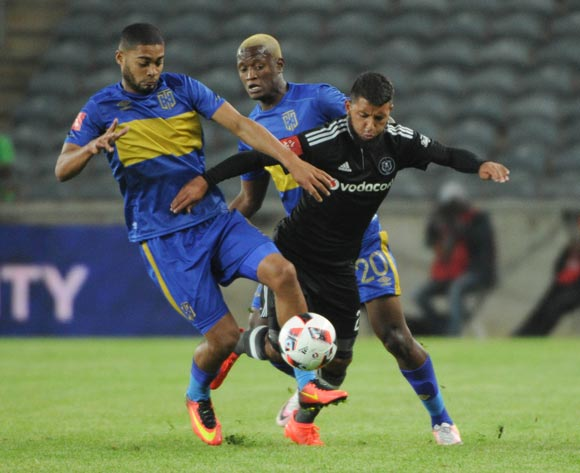 Riyaad Norodien of Orlando Pirates challenges Ebrahim Seedat of Cape Town City during the Absa Premiership match between Orlando Pirates and Cape Town City on the  20 September 2016 at Orlando Stadium  Pic Sydney Mahlangu/ BackpagePix