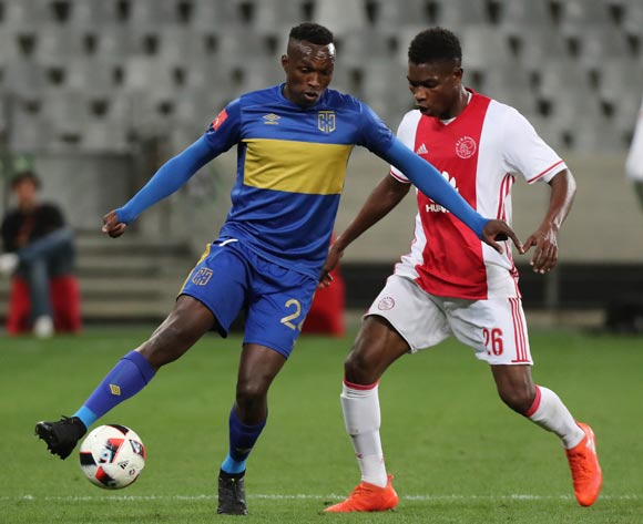Sibusiso Masina of Cape Town City FC evades challenge from Lawrence Lartey of Ajax Cape Town during the Absa Premiership 2016/17 football match between Cape Town City FC and Ajax Cape Town at Cape Town Stadium, Cape Town on 23 September 2016 ©Chris Ricco/BackpagePix