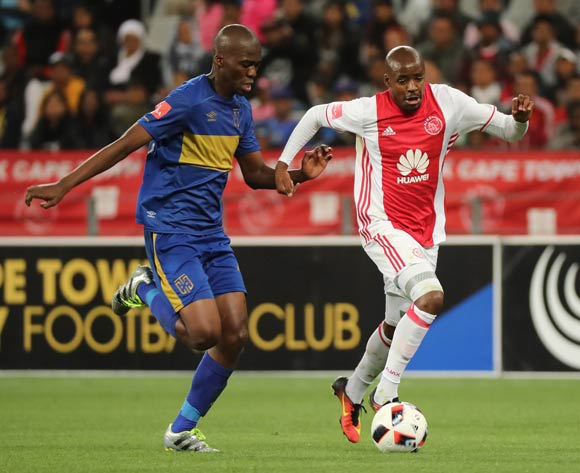 Bantu Mzwakali of Ajax Cape Town gets away from Mpho Matsi of Cape Town City FC during the Absa Premiership 2016/17 football match between Cape Town City FC and Ajax Cape Town at Cape Town Stadium, Cape Town on 23 September 2016 ©Chris Ricco/BackpagePix