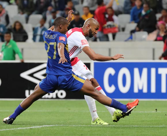 Nathan Paulse of Ajax Cape Town fires a shot past Tshepo Gumede of Cape Town City FC during the Absa Premiership 2016/17 football match between Cape Town City FC and Ajax Cape Town at Cape Town Stadium, Cape Town on 23 September 2016 ©Chris Ricco/BackpagePix