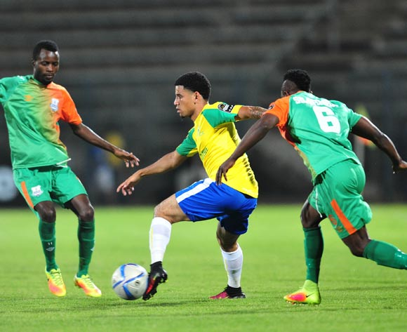 Keagan Dolly (c) of Mamelodi Sundowns challenged by Simon Silwimba (r) of Zesco during the 2016 CAF Champions League match between Mamelodi Sundowns and Zesco at the Lucas Moripe Stadium in Pretoria, South Africa on September 24, 2016 ©Samuel Shivambu/BackpagePix