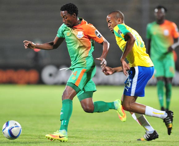 Jackson Mwanza of Zesco challenged by Tiyani Mabunda of Mamelodi Sundowns during the 2016 CAF Champions League match between Mamelodi Sundowns and Zesco at the Lucas Moripe Stadium in Pretoria, South Africa on September 24, 2016 ©Samuel Shivambu/BackpagePix