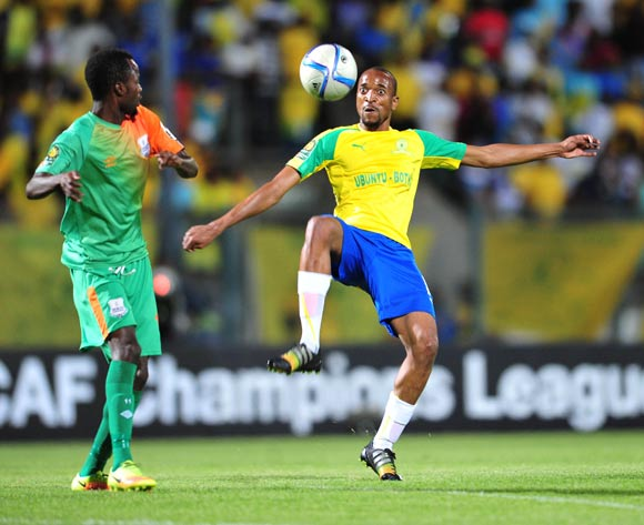 Tiyani Mabunda of Mamelodi Sundowns challenged by John Chingandu of Zesco during the 2016 CAF Champions League match between Mamelodi Sundowns and Zesco at the Lucas Moripe Stadium in Pretoria, South Africa on September 24, 2016 ©Samuel Shivambu/BackpagePix