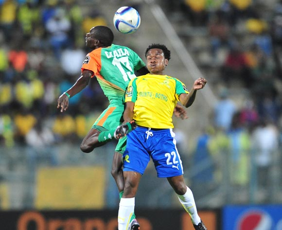 Percy Tau of Mamelodi Sundowns challenged by Misheck Chaila of Zesco during the 2016 CAF Champions League match between Mamelodi Sundowns and Zesco at the Lucas Moripe Stadium in Pretoria, South Africa on September 24, 2016 ©Samuel Shivambu/BackpagePix