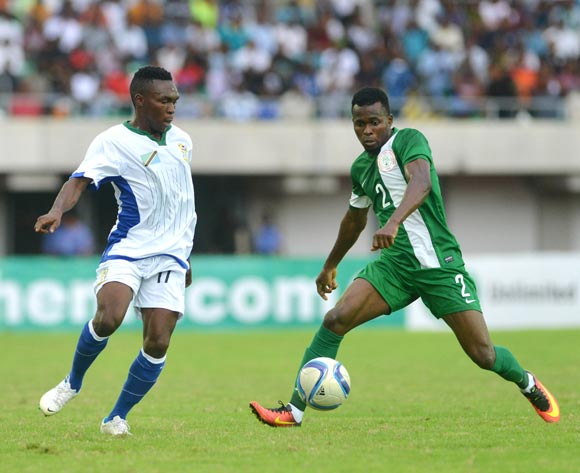 Musa Mohammed of Nigeria (right) challenges Shiza RamadhanTahaya of Tanzania in Uyo in September