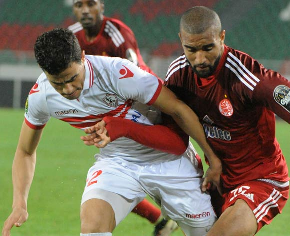 Ismail Al Haddad (R) of Wydad Casablanca vies for the ball against Ahmed Tawfik Mohamed Hassan (L) of Zamalek during the African Champions League (CAF) semi-final leg soccer match between Zamalek and Wydad Casablanca at Moulay Abdellah Stadium in Rabat, Morocco, 24 September 2016.  EPA/ABDELHAK SENNA