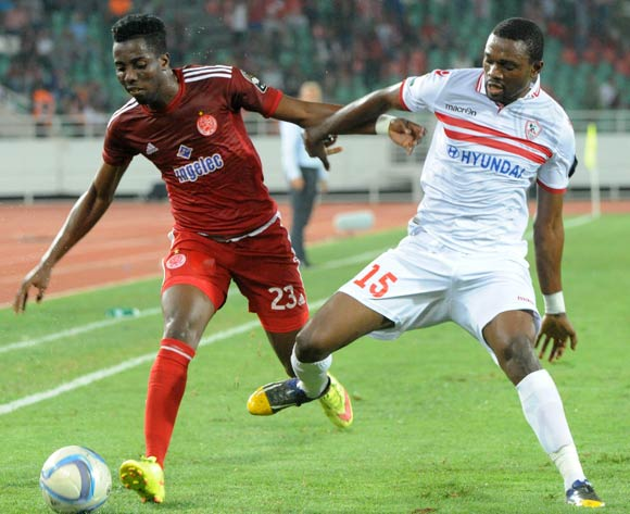 Chisom Elvis Chikatara (L) of Wydad Casablanca vies for the ball with Maroof Isuf (R) of Zamalek during the African Champions League (CAF) semi-final leg soccer match between Zamalek and Wydad Casablanca at Moulay Abdellah Stadium in Rabat, Morocco, 24 September 2016.  EPA/ABDELHAK SENNA