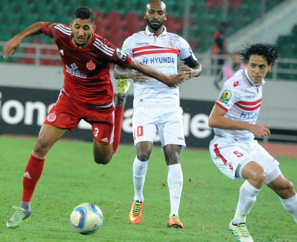 Fahd Aktaou (L) of Wydad Casablanca vies for the ball with Mahmoud Fadlallah  (C) and Ibrahim Mohamed (R) of Zamalek during the African Champions League (CAF) semi-final leg soccer match between Zamalek and Wydad Casablanca at Moulay Abdellah Stadium in Rabat, Morocco, 24 September 2016.  EPA/ABDELHAK SENNA