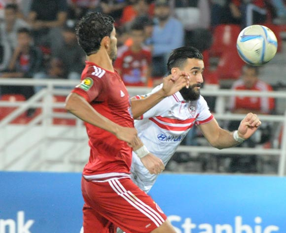Amin Atouchi (L) of Wydad Casablanca vies for the ball with Bassem Morsy (R) Zamalek during the African Champions League (CAF) semi-final leg soccer match between Zamalek and Wydad Casablanca at Moulay Abdellah Stadium in Rabat, Morocco, 24 September 2016.  EPA/ABDELHAK SENNA