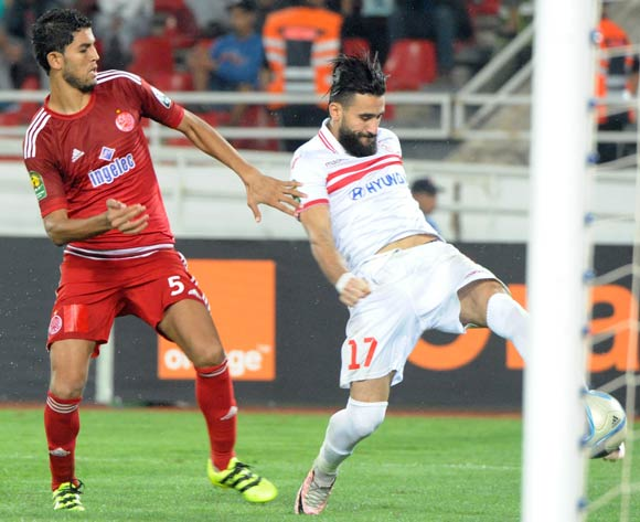 Amin Atouchi (L) of Wydad Casablanca vies for the ball with Bassem Morsy (R) of Zamalek during the African Champions League (CAF) semi-final leg soccer match between Zamalek and Wydad Casablanca at Moulay Abdellah Stadium in Rabat, Morocco, 24 September 2016.  EPA/ABDELHAK SENNA