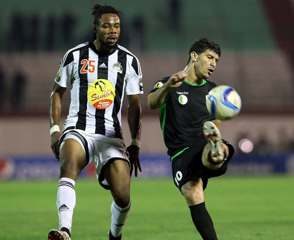Mouloudia Olympique Bejaia player Faouzi Yaya (R) and TP Mazembe player Christian Luyindama  Nekadio (L) fight for the ball