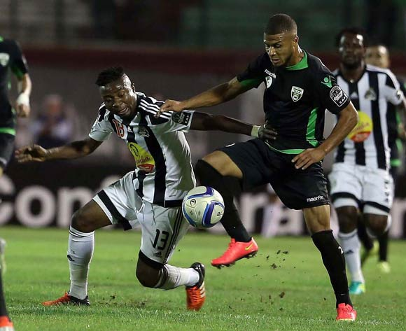 epa05609110 Mouloudia Olympique Bejaia player Morgan Benmelouka (R) and TP Mazembe player  Nathan  Sinkala (L) fight for the ball during the Final first leg CAF Confederation Cup soccer match between Mouloudia olympique Bejaia of Algeria and TP Mazembe of Congo in Blida km south of Algiers, Algeria, 29 October 2016. The second leg is scheduled for 6 November in Lubumbashi.  EPA/STR