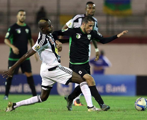 epa05609118 Mouloudia Olympique Bejaia player  Faouzi Rahal  (R) and TP Mazembe player Merveille Bope (L) fight for the ball during the Final first leg CAF Confederation Cup soccer match between Mouloudia olympique Bejaia of Algeria and TP Mazembe of Congo in Blida km south of Algiers, Algeria, 29 October 2016. The second leg is scheduled for 6 November in Lubumbashi.  EPA/STR