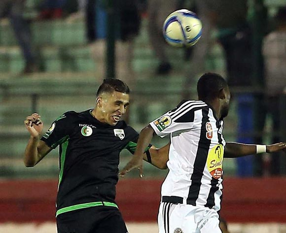 epa05609119 Mouloudia Olympique Bejaia player  Mohamed Yacine Athmani  (L) and TP Mazembe player Deogracias Kanda A Mujok (R) fight for the ball during the Final first leg CAF Confederation Cup soccer match between Mouloudia olympique Bejaia of Algeria and TP Mazembe of Congo in Blida km south of Algiers, Algeria, 29 October 2016. The second leg is scheduled for 6 November in Lubumbashi.  EPA/STR