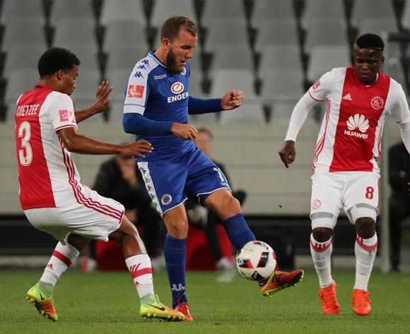 Jeremy Brockie of SuperSport United evades challenge from Rivaldo Coetzee of Ajax Cape Town (l) and Ndiviwe Mdabuka of Ajax Cape Town during the Absa Premiership 2016/17 football match between Ajax Cape Town and SuperSport United at Cape Town Stadium, Cape Town on 29 October 2016 ©Chris Ricco/BackpagePix