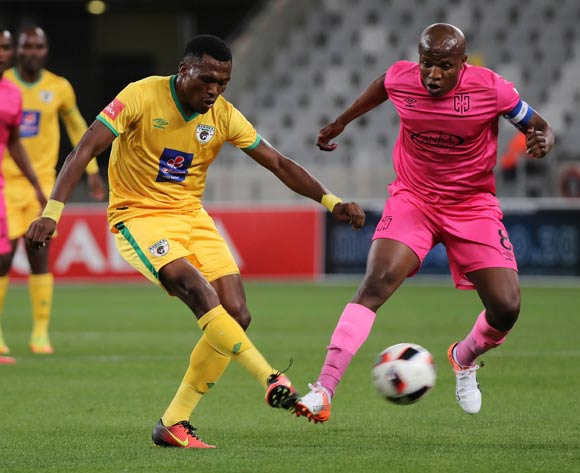 Mndeni Zikalala of Baroka FC evades challenge from Lebogang Manyama of Cape Town City FC during the Absa Premiership 2016/17 football match between Cape Town City FC and Baroka FC at Cape Town Stadium, Cape Town on 15 October 2016 ©Chris Ricco/BackpagePix