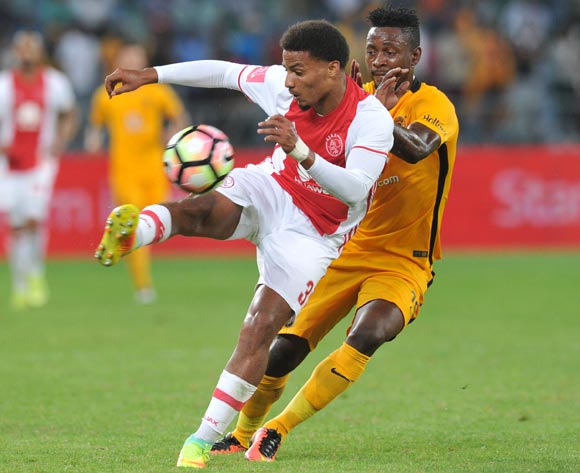 Rivaldo Coetzee of Ajax Cape Town clears the ball from Lewis Macha of Kaizer Chiefs during the Absa Premiership 2016/17 match between Kaizer Chiefs and Ajax Cape Town at Moses Mabhida Stadium, KwaMashu South Africa on 15 October 2016 ©Muzi Ntombela/BackpagePix