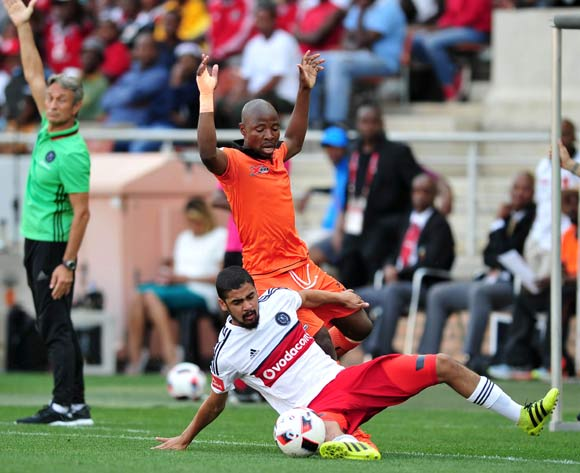 Abbubaker Mobara of Orlando Pirates challenged by Puleng Tlolane of Polokwane City during the Absa Premiership match between Polokwane City and Orlando Pirates at the Peter Mokaba Stadium in Polokwane on 16 October 2016©Samuel Shivambu/Backpagepix